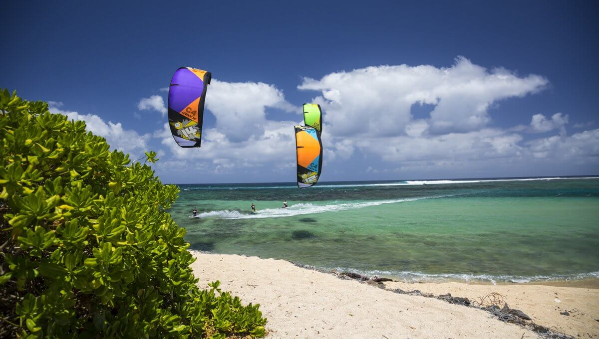 Ozone Kites Colorfully Flying Over The Ocean