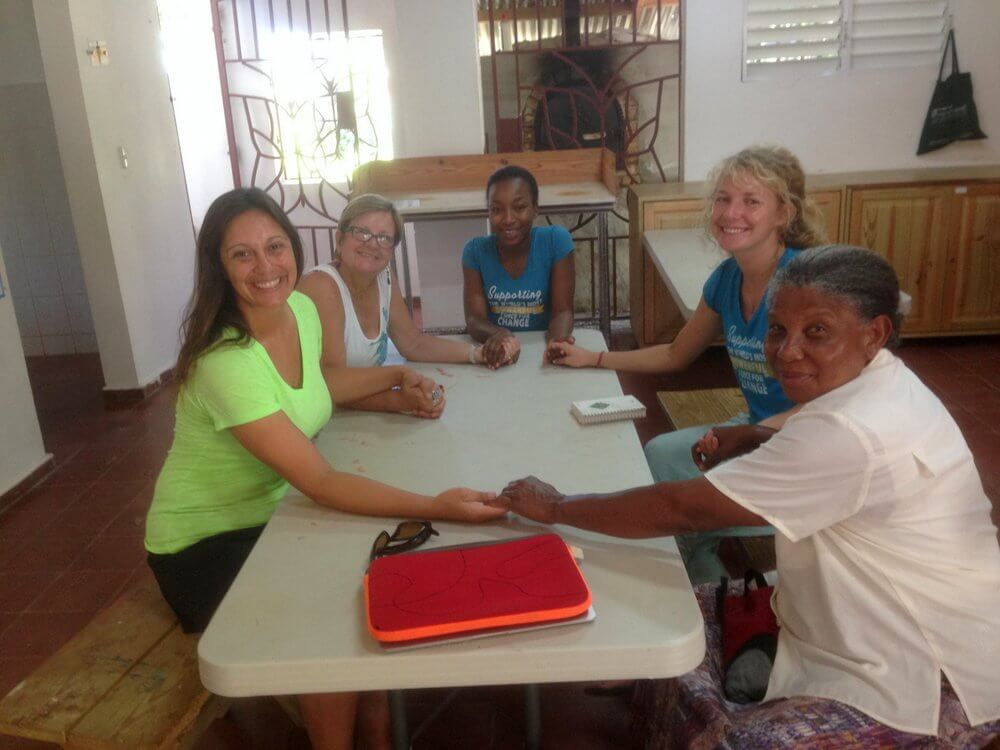 The Mariposa team and Laurel in a planning meeting