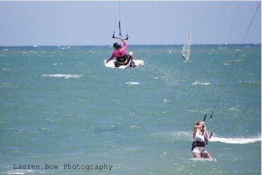 Professional kiteboarder Laurel Eastman jumping high in Cabarete Bay