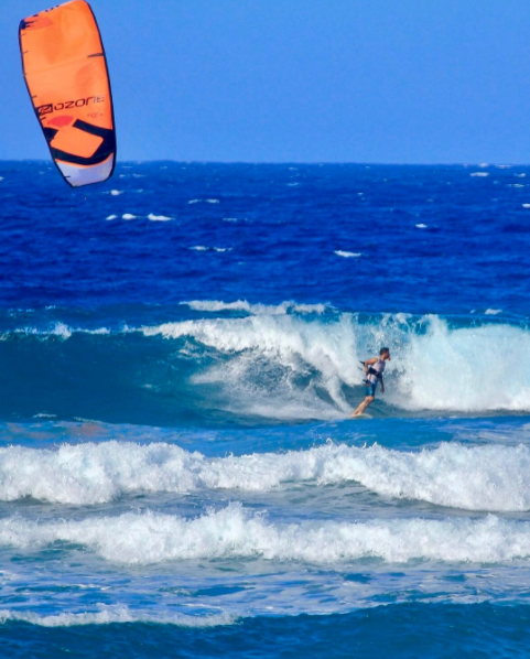 kiteboarder oron kessel riding waves on an Ozone kite in Cabarete